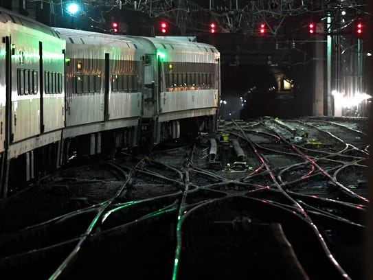 A NJ Transit train enters Penn Station crossing over
