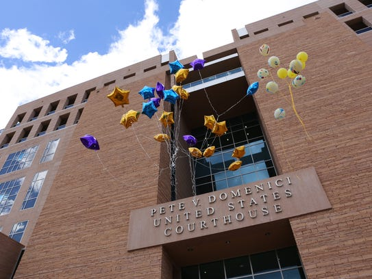 Balloons are released outside the Pete V. Domenici United States Courthouse in Albuquerque on Friday after Tom Begaye Jr. was sentenced to life in prison without the possibility of release in the murder of Ashlynne Mike.