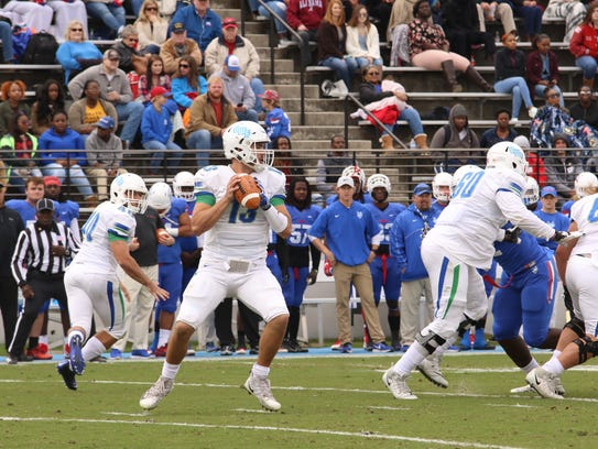 UWF quarterback Mike Beaudry drops back to pass against