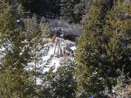 A pump jack sits on Ch'ooshgai Mountain near Red Valley,