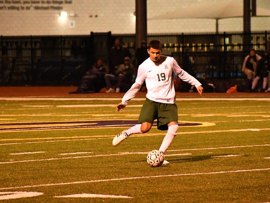 Senior Jesus Ochoa works the ball in the middle of