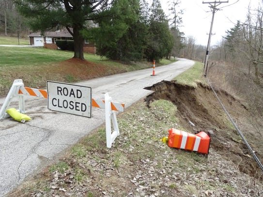 A portion of Smart Road in Mifflin Township slide further