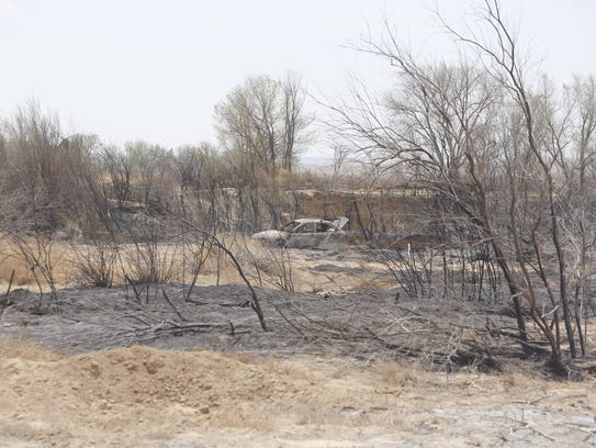 An abandoned vehicle was burned during a fire on Sunday in the Mesa Farm area in Shiprock.