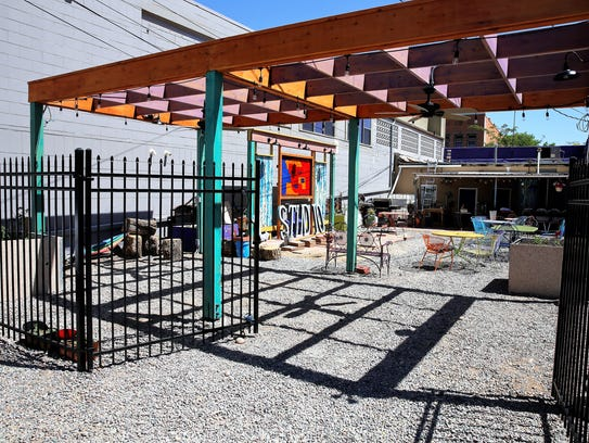 A wrought-iron fence separates the new pocket park