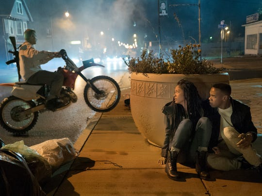 """Nya (Lex Scott Davis) and Isaiah (Joivan Wade) hide in """"The First Purge."""""""