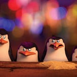 "Kowalski, left, (voiced by Chris Miller), Skipper (voiced by Tom McGrath), Rico (voiced by John DiMaggio) and Private (voiced by Christopher Knights) get caught up in the Shanghai Market in ""The Penguins of Madagascar."""