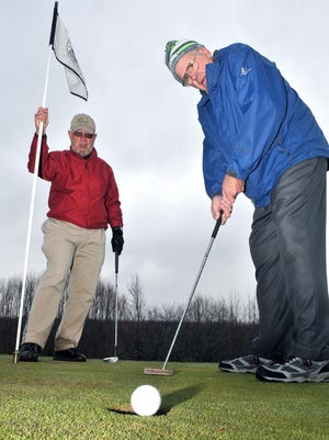 Mike McDonald, left, and Pete Bentley turned to golf last week at the Grand Traverse Resort.