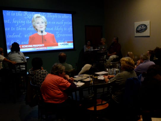 Democrats watch the first presidential debate at Craft