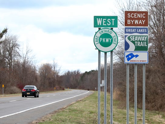 Traffic moves along the Lake Ontario State Parkway