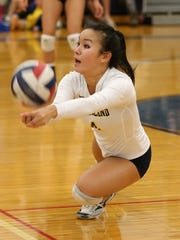 Sutherland's Aliah Bowllan dives to keep the ball alive against Victor.