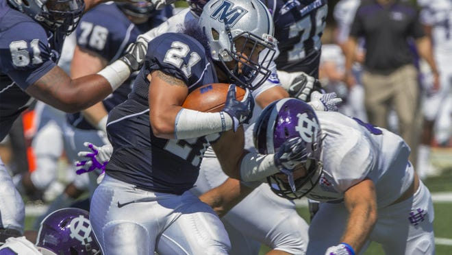 Monmouth University's Lavon Chaney carries ball down the right side during first half action. Holy Cross vs Monmouth University football in opening game of season. on September 5, 2015.