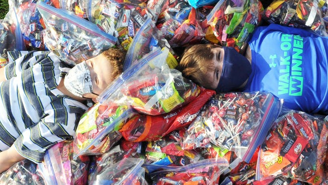 "Friends from left, Charlie Boynton, 7, and Dio Vessiropoulos, 10, both of Easton,  on Saturday, Nov. 7, 2020 collected excess Halloween candy this week to send off to Operation Stars & Stripes for their 'Operation Trick-Or-Treating For the Troops""."