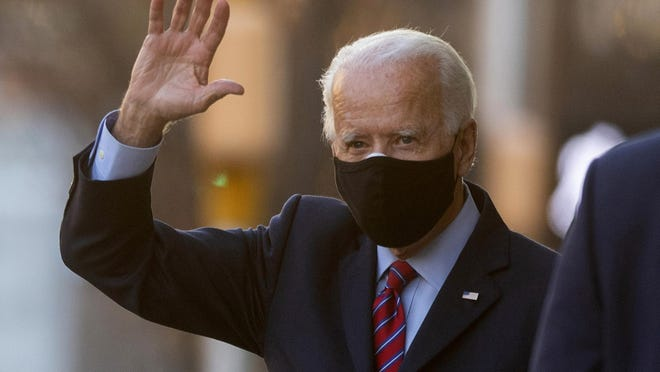 President-elect Joe Biden waves as he departs the Queen Theatre after meeting virtually with the United States Conference of Mayors in Wilmington, Del, on Monday, Nov. 23, 2020.