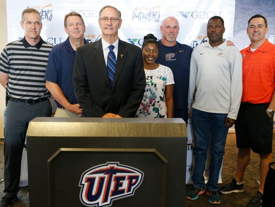 Athletic Director Bob Stull stands with most of  the