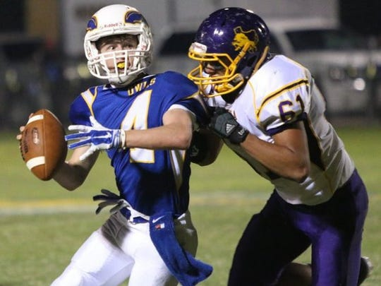 Reagan County's Mason Baggett is sacked by Ozona's