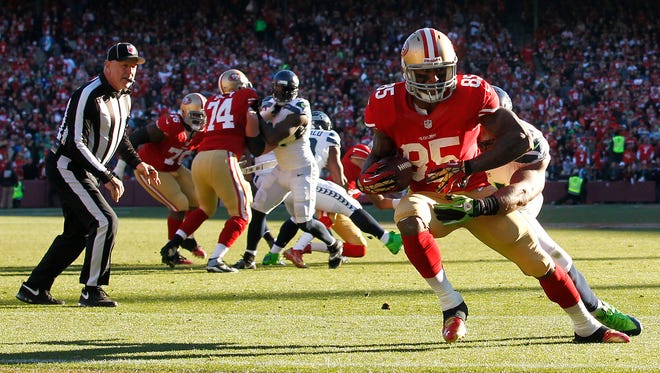 San Francisco 49ers tight end Vernon Davis (85) catches a touchdown pass against the Seattle Seahawks in the second quarter at Candlestick Park in San Francisco on Dec. 8, 2013. The 49ers won, 19-17.