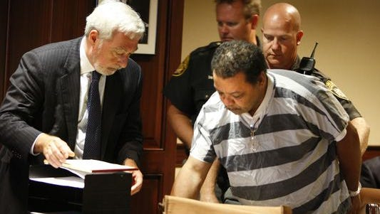 Kenneth Douglas, right, with his attorney Norman Aubin, signs his plea agreement, guilty to gross abuse of a corpse, in the Hamilton County Common Pleas Courtroom of Judge William Mallory, Jr.Thursday September 4, 2008. Douglas is accused of having sex with the body of murder victim Karen Range, while Ranges' body was at the Hamilton County morgue in 1982. (Photo: The Enquirer/Gary Landers)