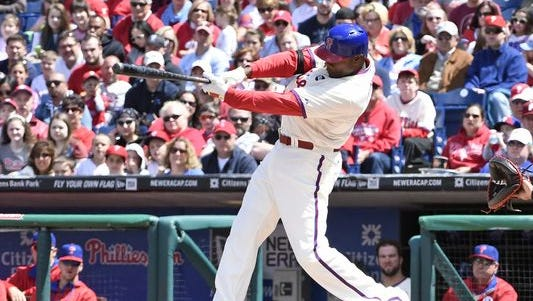 Ryan Howard hits a three run home run ing the first inning Sunday to start the Phillies on their way to a 5-4 win against the Atlanta Braves at Citizens Bank Park.