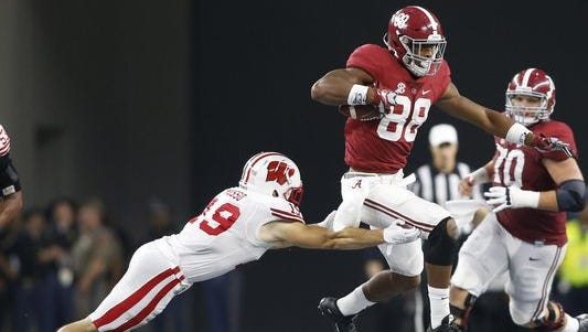 Alabama tight end O.J. Howard finished with three catches for 37 yards in Saturday's 35-17 win over Wisconsin.