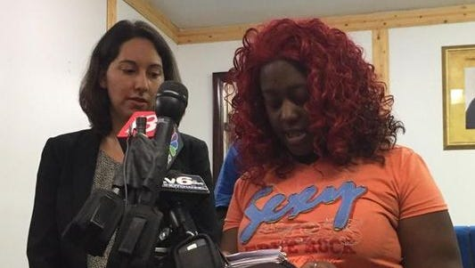 Rachel Long, right, backed up by attorney Ruth Brown reads a statement during a press conference, Thursday, September 10, 2015, to announce a lawsuit filed against IMPD in the death of Donte Sowell. Long is Sowell's fiancee.
