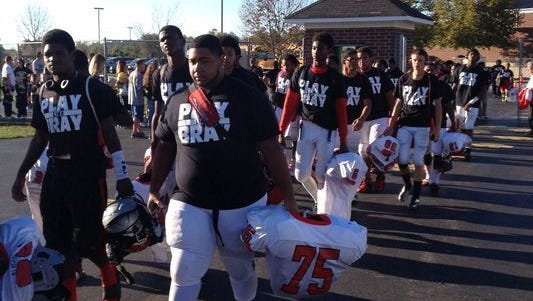The Mount Healthy High School football team shows up wearing Play Like Bray shirts in support of the Little Miami community after Brayden Thornbury's death in 2014.