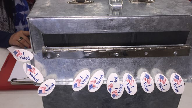 """A ballot box at a Cascade County poll at Montana Expo Park offers voters """"I Voted"""" stickers. The polls in Montana are open until 8 p.m. May 25 for Montana's special election."""