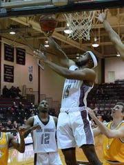 McMurry's LaRandall Scroggins goes up for a layup during the War Hawks' 85-69 loss to LeTourneau in an American Southwest Conference matchup Thursday at Kimbrell Arena.