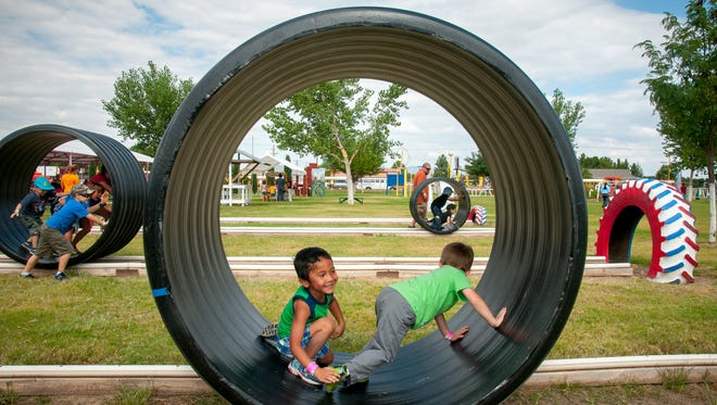 Discovery Child Development Center students Christian Schaper, left, and Riley Francis, both age 4, have fun in a hamster wheel at the Mesilla Valley Maze in this 2015 photo.