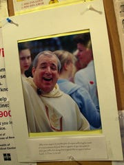 -  Photo of former priest Ralph LaBelle hangs at Sacred