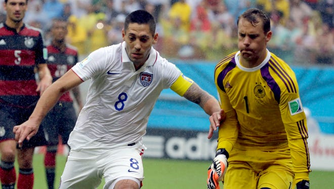 United States' Clint Dempsey chases the ball in front of Germany's goalkeeper Manuel Neuer during the group G World Cup soccer match between the USA and Germany at the Arena Pernambuco in Recife, Brazil, Thursday, June 26, 2014. (AP Photo/Ricardo Mazalan)