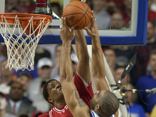 Indiana's A.J. Moye blocks the shot of Duke's Carlos Boozer (4) during the second half of their NCAA South Regional semifinal game at Rupp Arena.