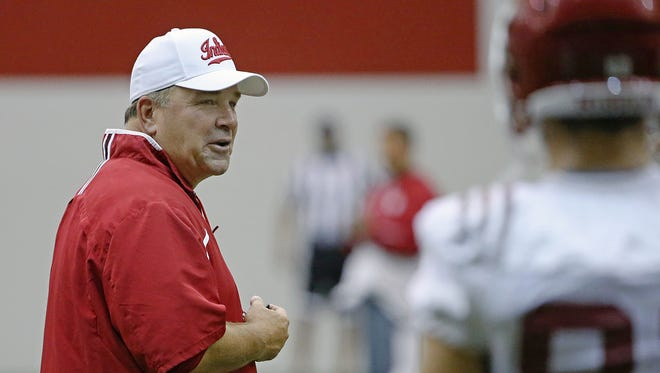 Left, head coach Kevin Wilson during Indiana University football practice at John Mellencamp Pavilion, Bloomington, Ind., Monday, August 15, 2016.