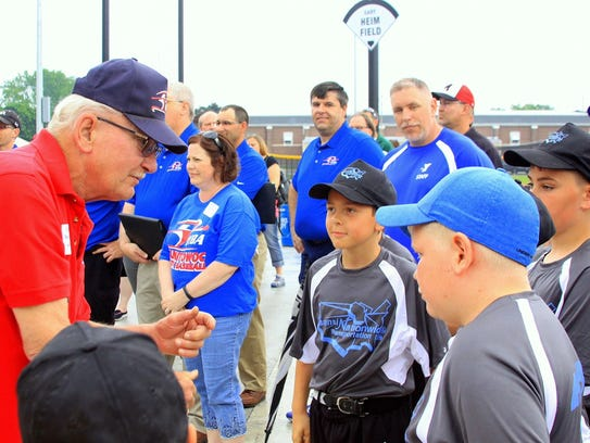 Gary Novak talks to players during the grand opening