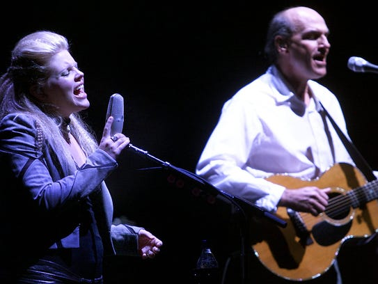 """Natalie Maines of the Dixie Chicks sings """"October Road"""" with James Taylor at Hancher Auditorium as part of the Vote for a Change tour in 2004."""