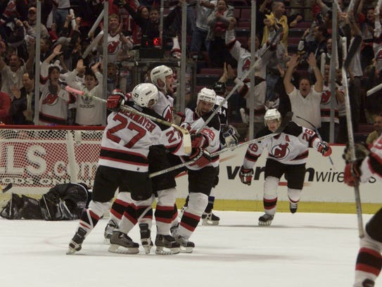 Grant Marshall's teammates congratulate him as he scores