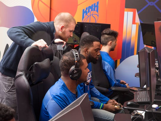 Kyle Rudy, who coaches Knicks Gaming, watches his players