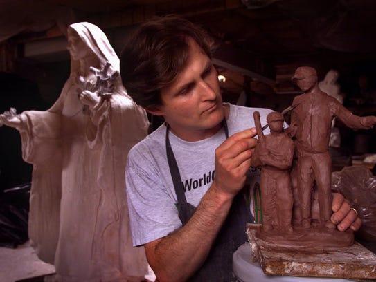 In 1999, Brian Hanlon sculpts model of memorial commemorating