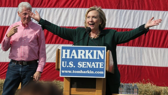"""Sen. Hillary Clinton says """"I'm back,"""" to a large crowd of screaming supporters during the annual Harkin Steak Fry on Sunday, Sept. 14, 2014, in Indianola, Iowa."""