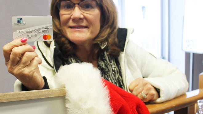 Lori Hunt, director of the Coldwater Area Chamber of Commerce, will sell $50 chamber gift cards for $25 starting Monday, through a program hosted by Consumers Energy.