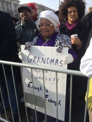 Barbara Cole, 77, of Florissant, Mo., held up a sign