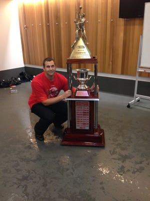 Former Indiana University manager Adam Tatalovich poses with the 2014 National Basketball League trophy.