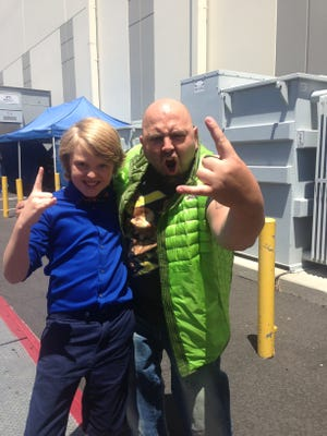 Anthony Smith on the set of Kids Baking Championship with judge and celebrity pastry chef Duff Goldman.