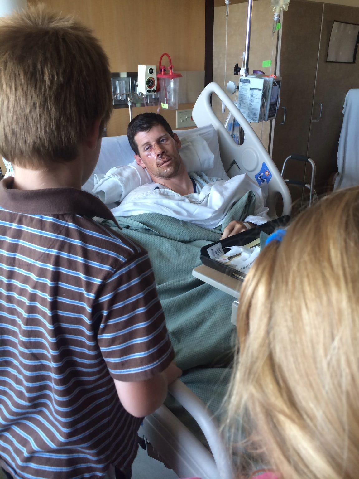 Bryce and Charlotte talk to their dad in the hospital