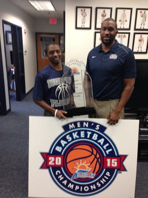 Byron Taylor and Frank Young pose with the A-Sun Trophy