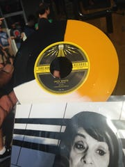 A customer shows off a tri-color limited edition vinyl purchased from the Rolling Record Store