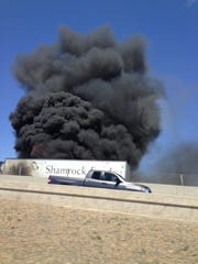 A Shamrock Farms semi truck on fire at the Loop 202