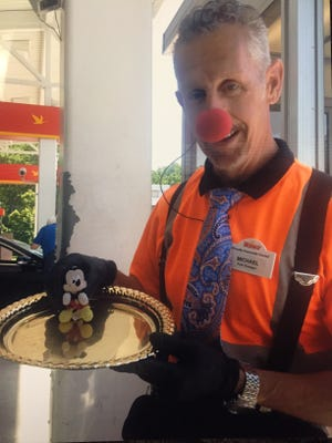 Michael Cuzzo, 57, of Brick, N.J., is shown wearing his clown nose while employed at Wawa.