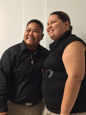Loretta M. Pangelinan, left, and Kathleen M. Aguero, right, both 28, pose prior to applying for a marriage license at the Office of Vital Statistics in the Guam Department of Public Health and Social Services on Wednesday, April 8, 2015.