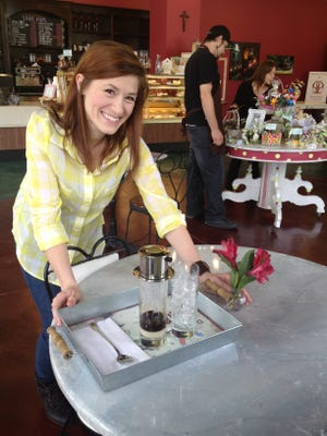 Indulge manager Rachael Judice with a tray of Vietnamese-style iced coffee dripping onto sweetened condensed milk. The sons of Food Network celebrity chef Paula Deen will be visiting Indulge Tuesday to film for an upcoming TV show.