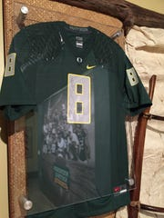 An autographed Marcus Mariota jersey is on display at the entrance to the Polynesian Football Hall of Fame on the island of Oahu in Hawaii.
